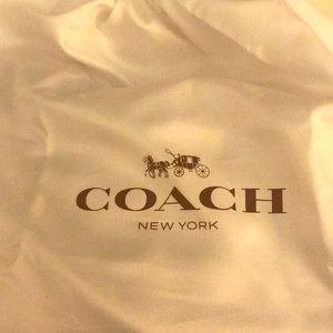 A fabric COACH bag.
